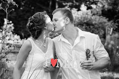 Big Love. Bride and groom kiss outdoor Stock Photos