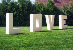 Big Love letters on a background of green park Royalty Free Stock Photos