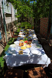 Big Lunch Table In Shadow Royalty Free Stock Photos