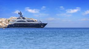 Big luxury beautiful yacht docked at summer sea but ready to travel. To tropical beautiful water stock image