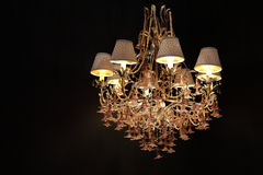 Big luxury chandelier. On dark Royalty Free Stock Images
