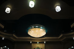 Big luxury chandelier in the interior of the restaurant. Big luxury chandelier in the restaurant interior Stock Photo