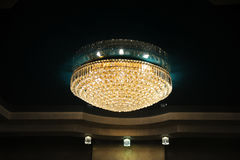 Big luxury chandelier in the interior of the restaurant. Big luxury chandelier in the restaurant interior Stock Photos