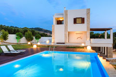 Big luxury pool with villa. Big pool and luxury villa in the afternoon stock photo