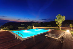 Big luxury pool with villa. Big pool and luxury villa in the afternoon stock images