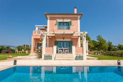Big luxury pool with villa. Luxury villa exterior with pool and beautiful decoration royalty free stock photography