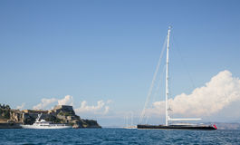 Big luxury private yacht on anchor before the town of Corfu on t Royalty Free Stock Images