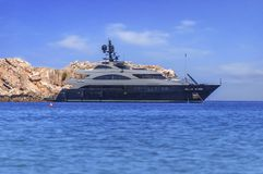 Big luxury yach docked at sea but ready to travel to tropical water. Big luxury yach docked at sea but ready to travel to tropical beautiful water stock photo