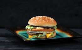 Big Mac Fast food. On black background royalty free stock photography