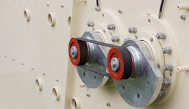 Big machine mechanism detail- serrated wheel system. Royalty Free Stock Images
