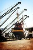 Big machines in Mar del Plata. Cranes and boat at Mar del Plata Shipyard , Argentina stock images