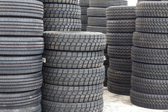 Big machines tires stack background. Industrial tires Stock Images