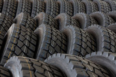 Big machines tires stack background. Industrial tires Royalty Free Stock Images