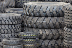 Big machines tires stack background. Industrial tires Royalty Free Stock Photography