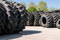 Big machines tires stack background. Industrial tires outside for sale.  royalty free stock photography