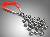 Big magnet attracting chrome bearing ball. Stock Photography