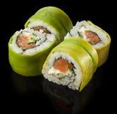 Big maki sushi. roll green dragon Stock Images