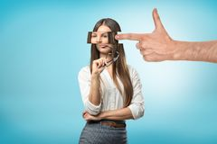 Big male hand with a finger pointing to a young woman with fragmented head on blue background vector illustration