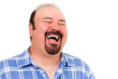 Big man having a hearty laugh. Of enjoyment and merriment with his head thrown back and eyes closed, isolated on white royalty free stock image