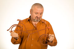 Big man holding scale model of the bike/bicycle Royalty Free Stock Photo