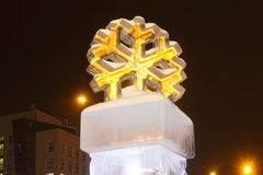Big man-made ice in city at winter night stock photos