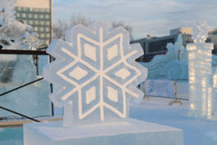 Big man-made ice and snowy snowflake in ice town Royalty Free Stock Photos
