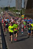 Riga, Latvia - May 19 2019: Big marathon crown running up to Vansu bridge royalty free stock image