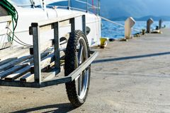 Big marina trolley for crew baggage on the pier Stock Image