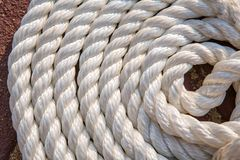 Big marine sea ropes in heap. Big white marine sea ropes in heap - the background Stock Photos