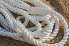 Big marine sea ropes in heap. Big white marine sea ropes in heap - the background Royalty Free Stock Photos