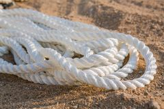 Big marine sea ropes in heap. Big white marine sea ropes in heap - the background Stock Image