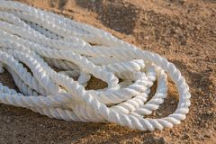 Big marine sea ropes in heap. Big white marine sea ropes in heap - the background Royalty Free Stock Photo