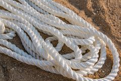 Big marine sea ropes in heap. Big white marine sea ropes in heap - the background Royalty Free Stock Photography
