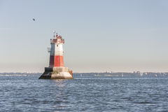 Big marine sign or lighthouse in sea Stock Photography