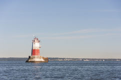 Big marine sign or lighthouse in sea Stock Photo