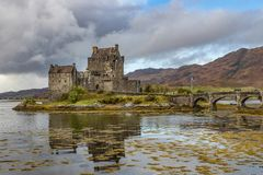 Medieval castle on the lake. Big medieval castle on the peaceful lake, Scotland, United Kingdom royalty free stock photos
