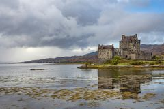 Medieval castle on the lake. Big medieval castle on the peaceful lake, Scotland, United Kingdom stock photos