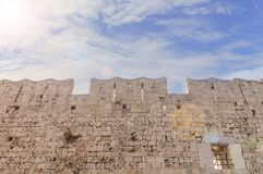 Big medieval old tower castle stone wall with sun and sky Stock Image
