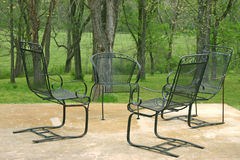 Big meeting. Four chairs wait for a good conversation in a park-like setting Royalty Free Stock Photography