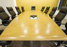 Big meeting room. Meeting room and a big table with a speakerphone Stock Photography