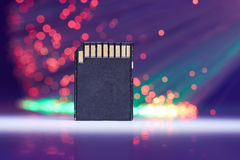 Big Memory Card. Data Concept On Background With Fiber Optics And Reflections On White  Lighted Table Royalty Free Stock Image
