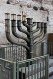 Big menorah on western wall background. Hanukkah menorah near the Western Wall in Jerusalem, Israel stock photo