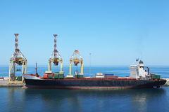 Big merchant ship with cargos on a board Royalty Free Stock Images