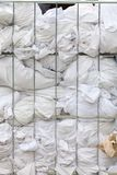 Big metal basket with hotel laundry Stock Images