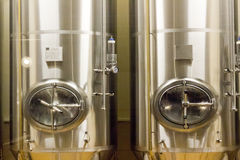 Big metal cisterns for beer at beer factory Royalty Free Stock Photo