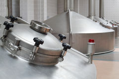 Big metal cisterns for beer in Ochakovo factory Stock Images