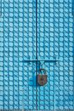 Big metal gate of blue color with patterns. Big metal gate of blue color with patterns, are closed on the huge padlock with the image of a hexagram and syllable Stock Photos