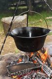 Big metal pot on camp fire Royalty Free Stock Photography