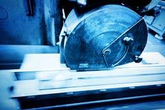 Big metal saw at work in workshop. Industrial Stock Images