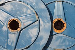 Big metal spools with hole for drive shaft Stock Image